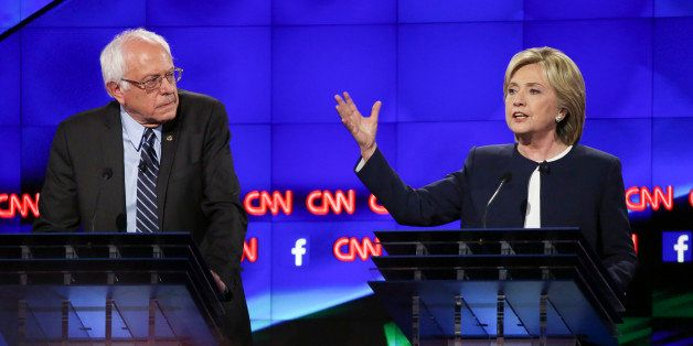 Hillary Clinton, former U.S. secretary of state, right, and Senator Bernie Sanders, an independent from Vermont, participate