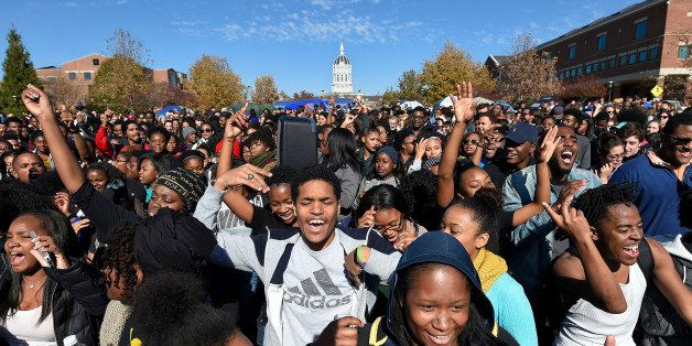 Student protesters on the campus of the University of Missouri in Columbia react to news of the resignation of University of