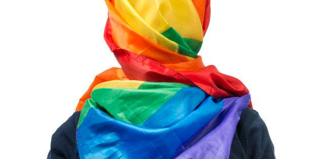 The human body wrapped in a gay flag which symbolises a muslim gay person.