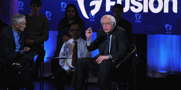 DES MOINES, IA - JANUARY 11:  Journalist Jorge Ramos and democratic presidential Bernie Sanders (R) pictured onstage during t