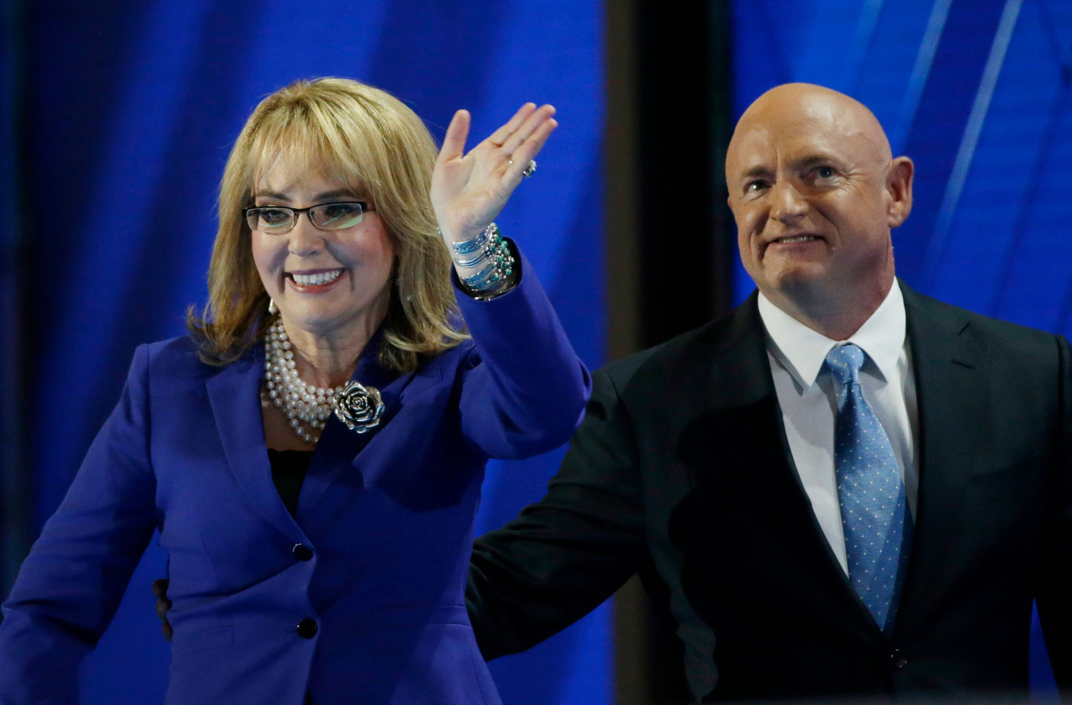 Former Rep. Gabby Giffords (D-AZ) leaves the stage with her husband retired Navy Captain Mark Kelly at the Democratic National Convention in Philadelphia, Pennsylvania, U.S. July 27, 2016. REUTERS/Gary Cameron