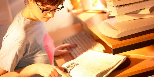 Young woman doing homework