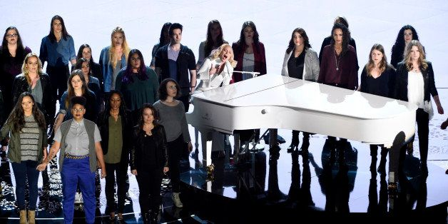 Lady Gaga performs with survivors of abuse at the Oscars on Sunday, Feb. 28, 2016, at the Dolby Theatre in Los Angeles. (Phot