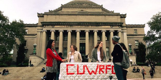 NEW YORK, NY - OCTOBER 29 :  Students stand in front of the Library of the Columbia University with a mattress in support of