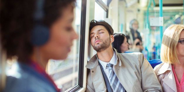 Businessman napping on train