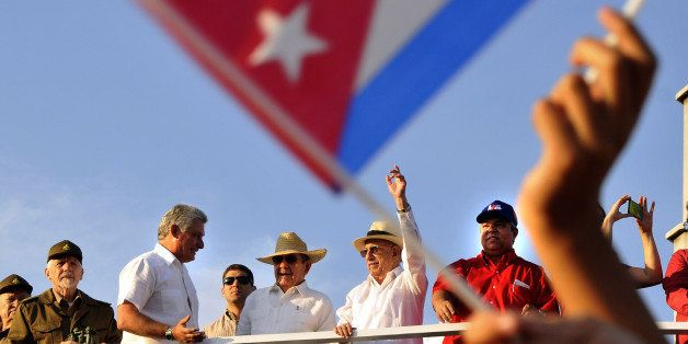 HAVANA, May 1, 2016-- Cuban leader Raul Castro, center, the Second Secretary of the Communist Party of Cuba Jose Ramon Machad