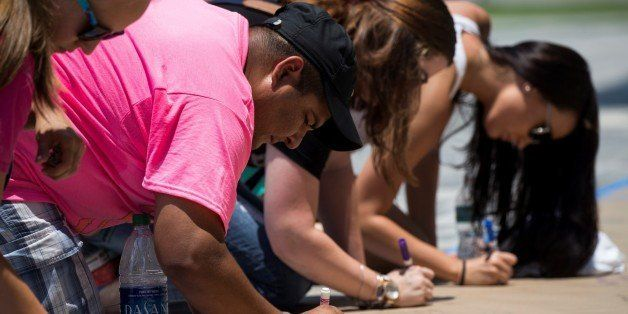ORLANDO, USA - JUNE 13: Mourners leave notes for the victims of the Pulse nightclub and First Responders at a make shift memo