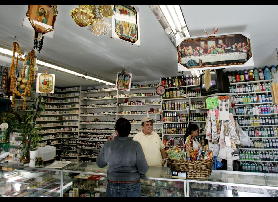 Patrons shop at the botanica San Lazarito in Jackson Heights, Queens. From New York to Los Angeles, from Chicago to Miami, pa