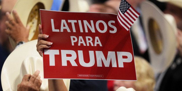 CLEVELAND, OH - JULY 21:  A delegate holds up sign that reads 'Latinos Para Trump' during the evening session on the fourth d
