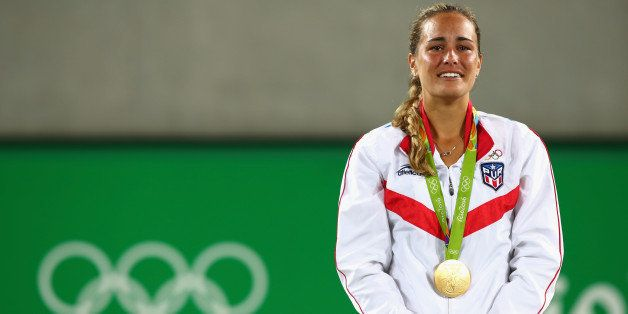 RIO DE JANEIRO, BRAZIL - AUGUST 13:  Gold medalist Monica Puig of Puerto Rico reacts during the medal ceremony for Women's Si