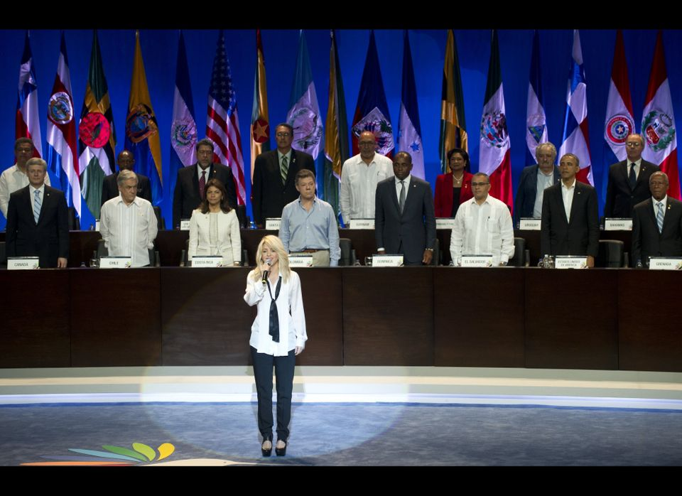 Colombian singer Shakira performs the Colombian National Anthem during the opening remarks of the Summit of the Americas at t