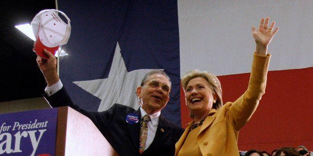 U.S. Democratic presidential candidate Senator Hillary Clinton (D-NY) waves with Congressman Ruben Hinojosa (D-TX) (L) at a c