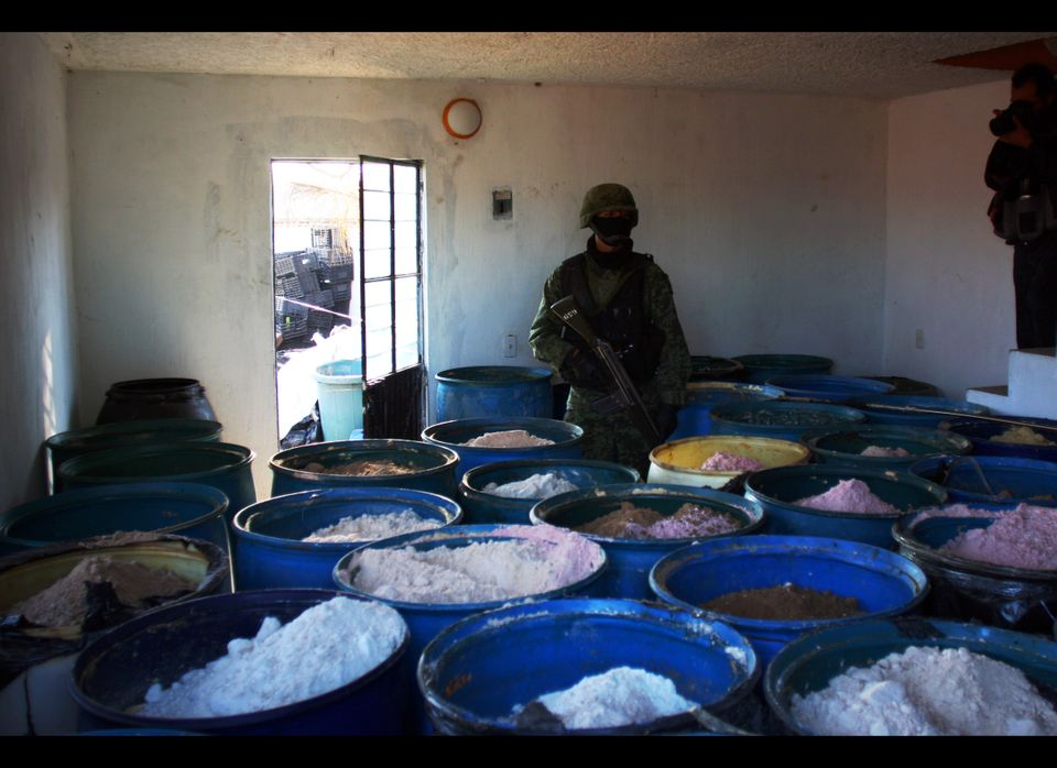 A soldier stands guard inside a clandestine chemical drugs processing laboratory discovered in Tlajomulco de Zuniga, on the o