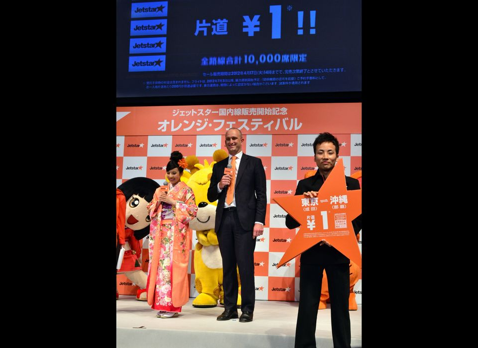 Bruce Buchanan (R), CEO of Qantas Airways' low cost subsidiary Jetstar Group, accompanied by Japanese actress and Jetstar Jap