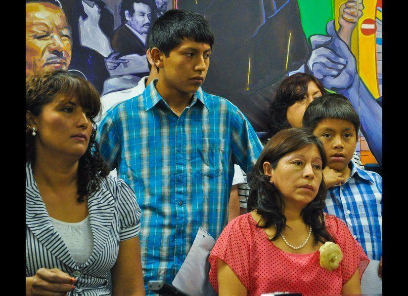 Maria Romero, and Carmen Ricsi with her son, Brian, 14 (left to right)