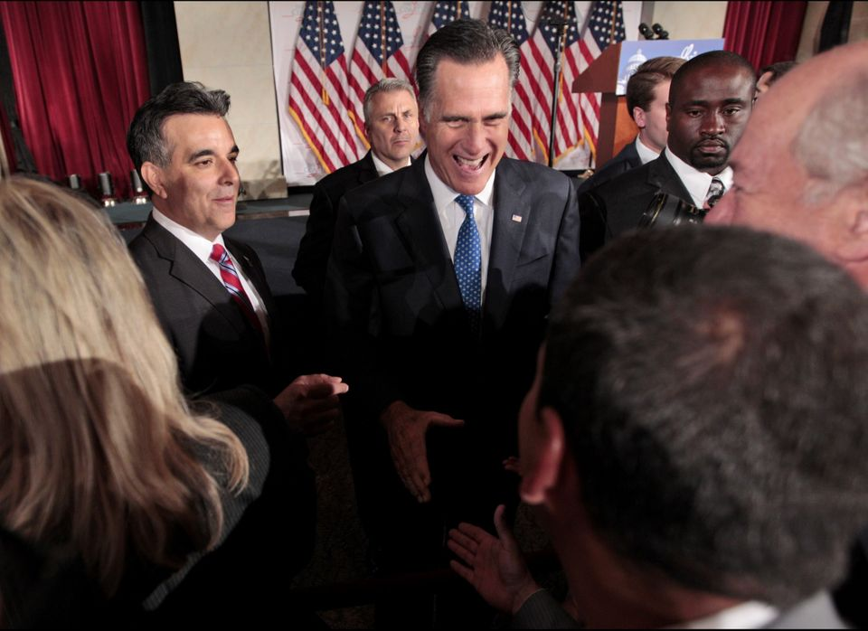 Mitt Romney, the de facto Republican presidential candidate, greets attendees at The Latino Coalition's Annual Economic Summi