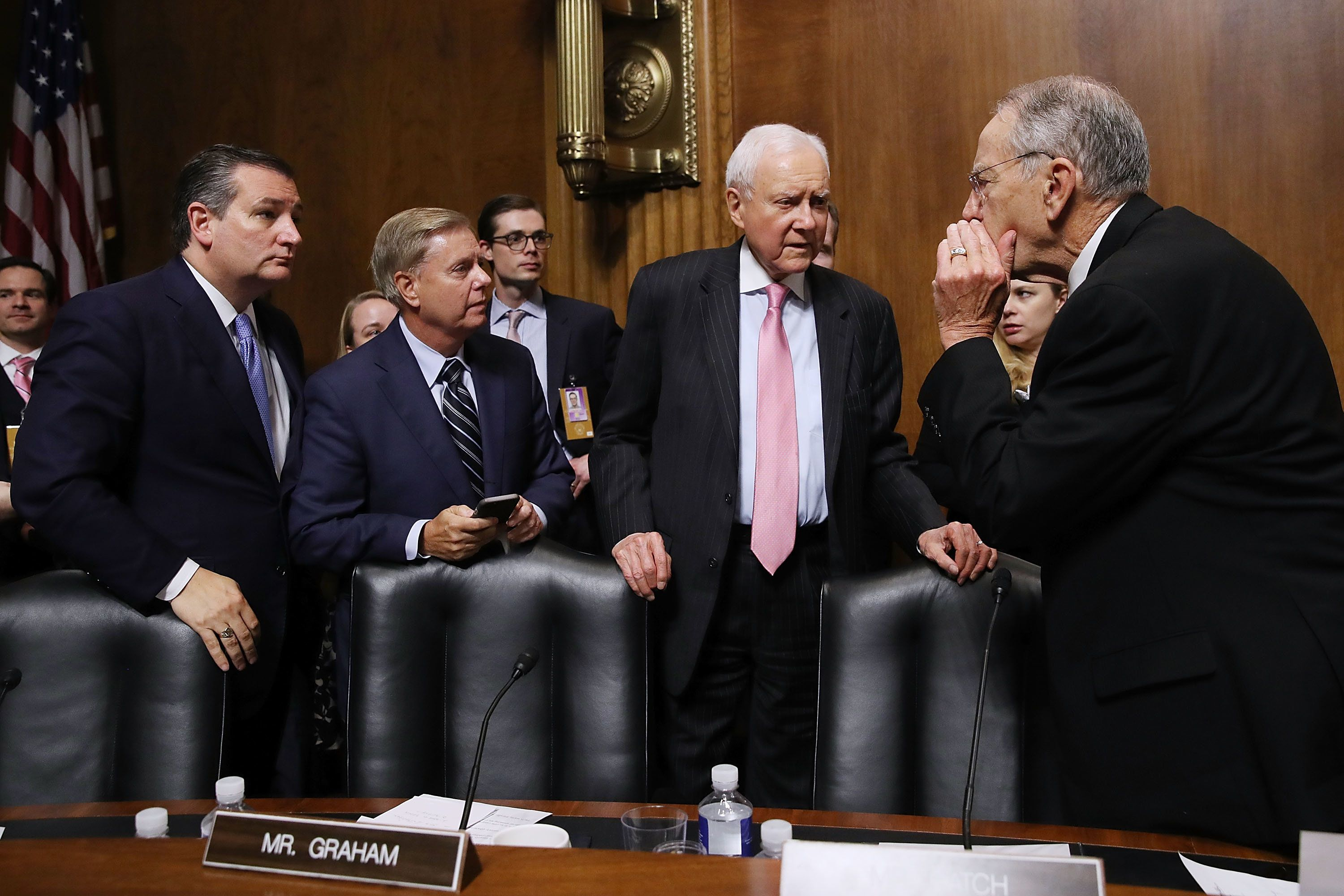 WASHINGTON, DC - SEPTEMBER 27:  Senate Judiciary Committee members (L-R) Sen. Ted Cruz (R-TX),  Sen. Lindsey Graham (R-SC), Sen. Orrin Hatch (R-UT) and Chairman Charles Grassley (R-IA) talk at the conclusion of the Supreme Court confirmation hearing for Judge Brett Kavanaugh in the Dirksen Senate Office Building on Capitol Hill September 27, 2018 in Washington, DC. Kavanaugh was called back to testify about claims by Christine Blasey Ford, who has accused him of sexually assaulting her during a party in 1982 when they were high school students in suburban Maryland.  (Photo by Win McNamee/Getty Images)