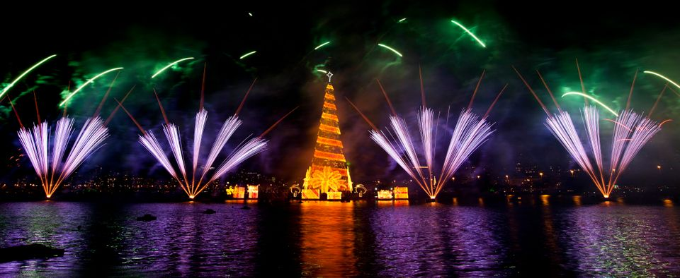 Fireworks explode over an 85-meter long floating Christmas tree at the Lagoa Rodrigo de Freitas neighborhood as it is lit for