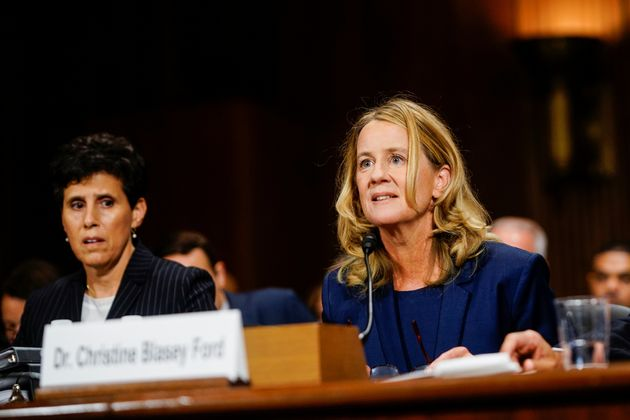 Christine Blasey Ford, with lawyer Debra S. Katz, left, answers questions at a Senate Judiciary Committee hearing.