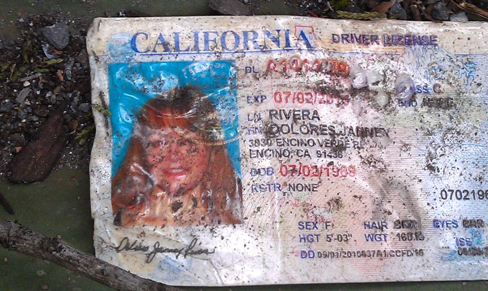 A California driver's license bearing the name of Jenni Rivera sits on the ground at the site where a plane allegedly carryin