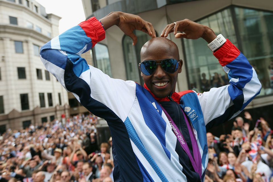 LONDON, ENGLAND - SEPTEMBER 10:  Mo Farah poses for a photograph during the London 2012 Victory Parade for Team GB and Paraly