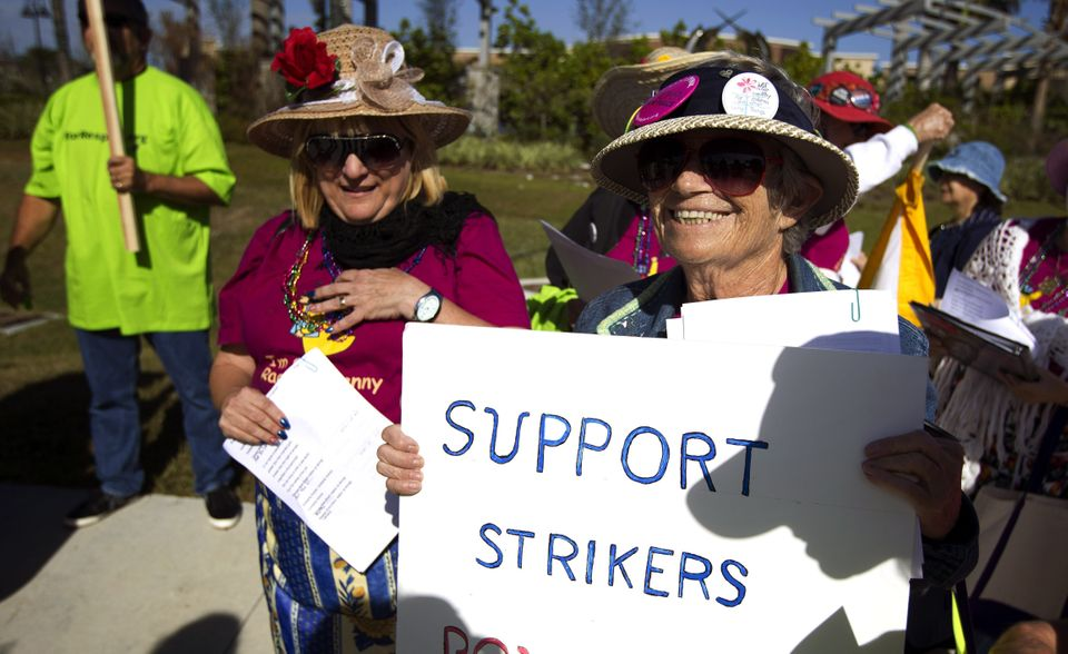 Demonstrators protest Wal-Mart in Boynton Beach, Fla., Friday, Nov 23, 2012. Wal-Mart employees and union supporters are taki