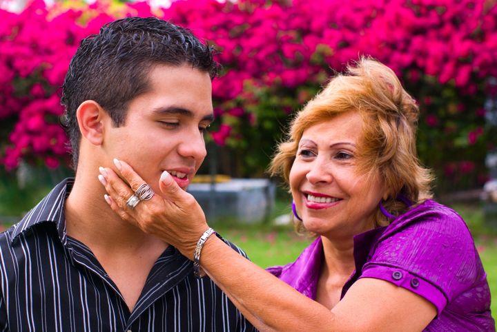 grandmother caressing teen boy...
