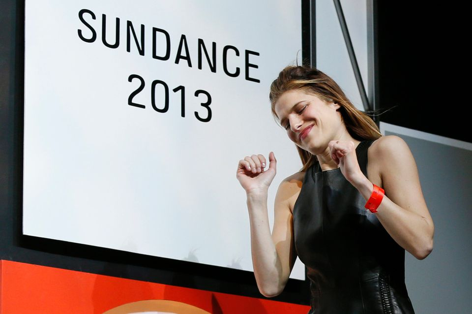 Director, writer and cast member Lake Bell celebrates as she comes on stage to accept her U.S. Dramatic Waldo Salt Screenwrit