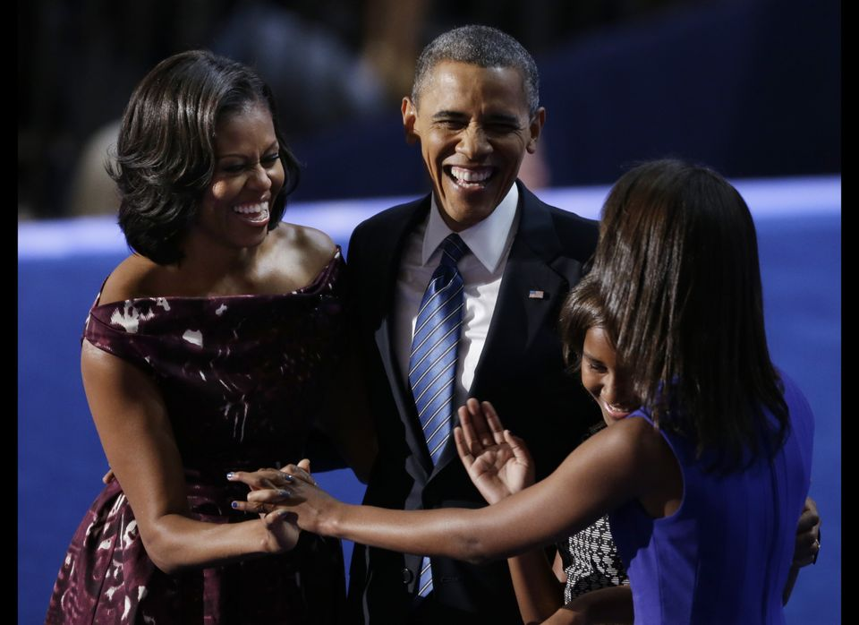 President Barack Obama laughs with his wife Michelle and his daughters Malia and Sasha after his speech to the Democratic Nat