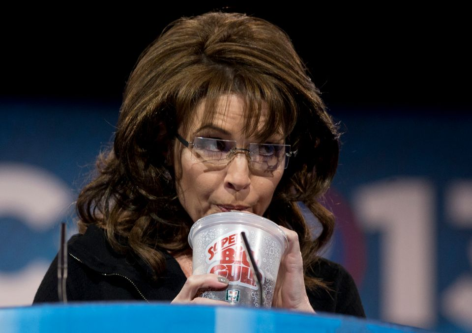 Former Alaska Gov. Sarah Palin drinks from a 7-Eleven Super Big Gulp on stage while speaking at the 40th annual Conservative
