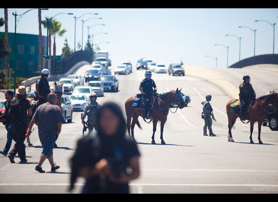 ANAHEIM, CA - JULY 29: A line of Orange County Police Officers block a freeway overpass leading to Disneyland during a protes