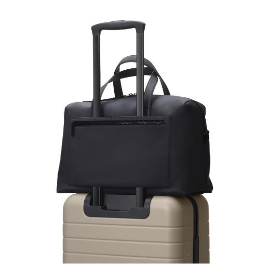 985ce2fc1ce 10 Practical Carry-On Bags That Attach To Your Suitcase