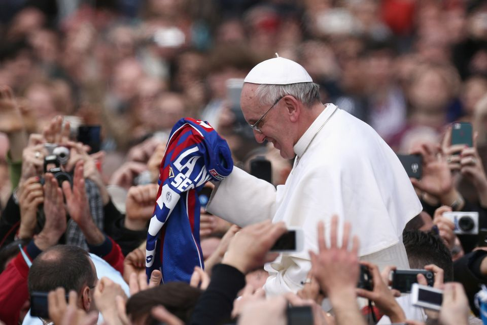 VATICAN CITY, VATICAN - MARCH 31:  Pope Francis is given a San Lorenzo's shirt, the Buenos Aires football team as he greets t