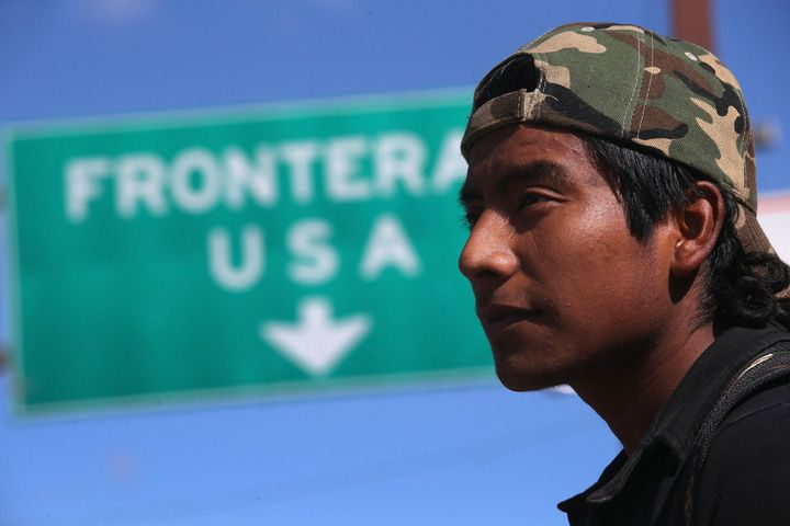 NOGALES, MEXICO - MARCH 10:  An immigrant walks near the U.S.-Mexico border after eating breakfast at the Kino Border Initiat