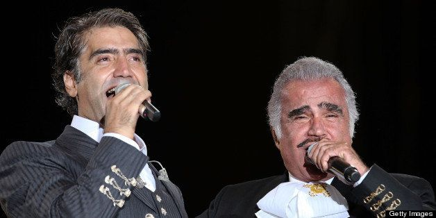 GUADALAJARA, MEXICO - JUNE 27:  Singers Alejandro Fernandez and his father Vicente Fernandez performs a duo during Jalisco en