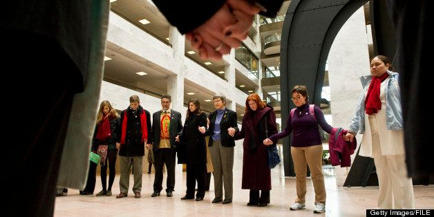 WASHINGTON, DC- Dec. 14: Participants in a 'Jericho March' and rally in support of the DREAM Act pray in the atrium of the Ha