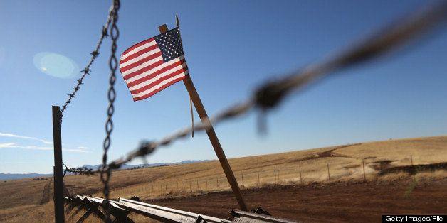 SONOITA, AZ - FEBRUARY 26:  An American flag flies at the U.S.-Mexico border on February 26, 2013 near Sonoita, Arizona. The