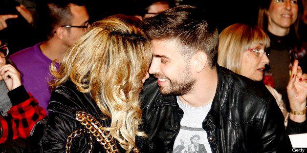 BARCELONA, SPAIN - MARCH 14:  Columbian singer Shakira and Barcelona footballer Gerard Pique attend a press conference for hi