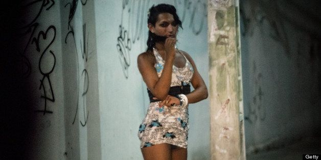 A prostitute stands along a street in Fortaleza, Ceara State, northeastern Brazil, on April 16, 2013. AFP PHOTO/Yasuyoshi CHI