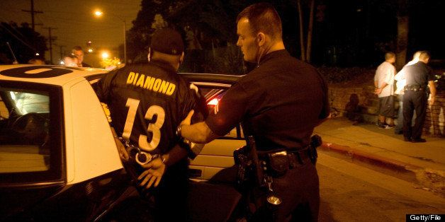 LOS ANGELES - AUGUST 4:  (US NEWS AND WORLD REPORT AND NEWSWEEK OUT)  A member of the Diamond Street hispanic street gang is