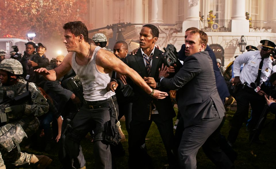 FILE - In this undated publicity photo provided by Sony Pictures Entertainment, Channing Tatum, left, and Jamie Foxx, center,