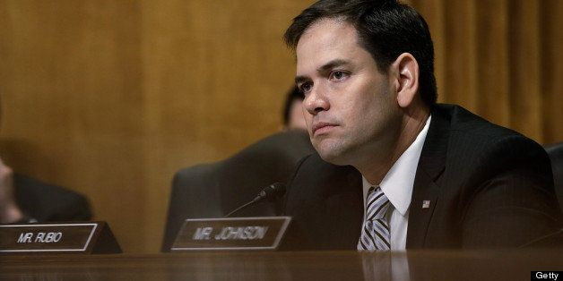 WASHINGTON, DC - APRIL 11:  U.S. Sen. Marco Rubio (R-FL) listens as U.S. Ambassador to the Syrian Arab Republic Robert Ford t