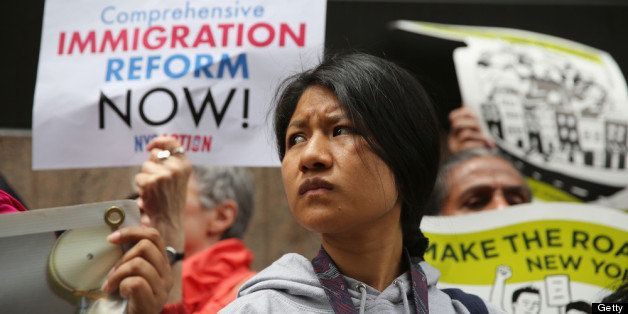 NEW YORK, NY - JUNE 14: Immigration reform advocates stage a demonstration, organized by the New York Immigration Coalition, outside a detention facility run by Immigration and Customs Enforcement (ICE) on June 14, 2013 in New York City. Demonstrators staged the event ahead of Fathers' Day to draw attention to the thousands of undocumented immigrant fathers deported by ICE and separated from their families in the United States. (Photo by John Moore/Getty Images)