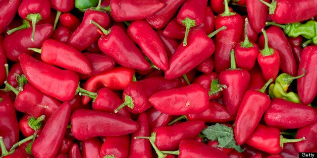 A large pile of Red Hot Jalapeno Chili Peppers at the farmers market at pike place market in seattle