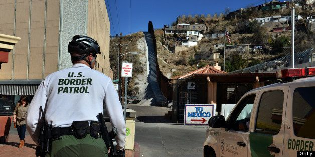 NOGALES, AZ - MARCH 2: U.S. Border Patrol officers patrol the streets of downtown Nogales, Arizona, with Nogales, Mexico, sta