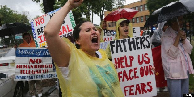 NEWARK, NJ - JUNE 13:  Immigrant rights activist Diana Mejia and fellow protesters stage a demonstration in front of the Immi