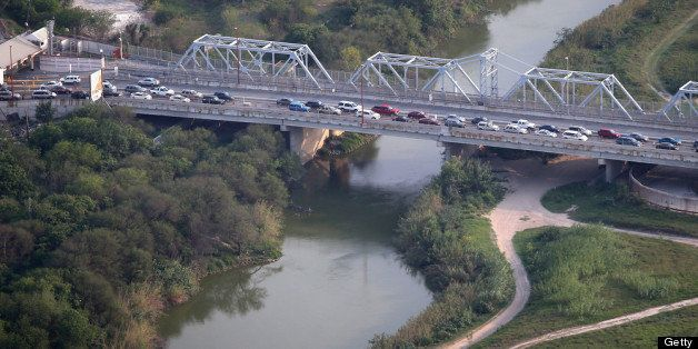 BROWNSVILLE TX - MAY 21:  Cars drive from Matomoros, Mexico (L), across the U.S.-Mexico border at the Rio Grande on May 21, 2