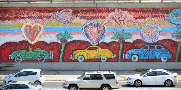 Traffic going north on US 101 flows past Frank Romero's 'Going to the Olympics' mural  in Los Angeles on August 15, 2013 in C