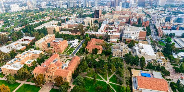 aerial view of campus of University of California in Los Angeles, with smoggy cityscape of  Los Angeles, California in the ba