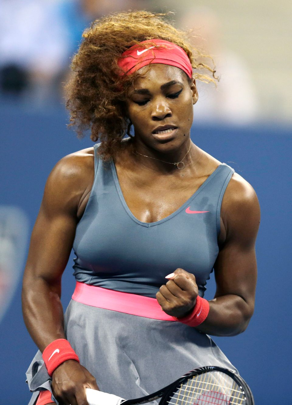 Serena Williams, of the United States, pumps her fist after winning a point against Carla Suarez Navarro, of Spain, during a